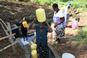 The Water Project:  Carrying Water Up The Cement Steps