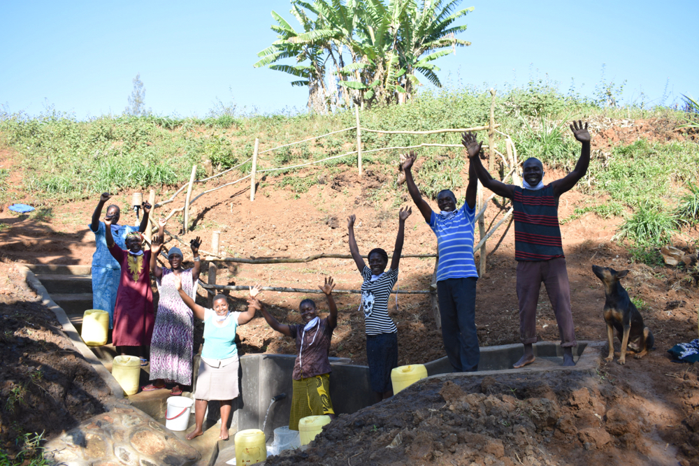 The Water Project : kenya21302-cheers-for-the-completed-spring
