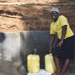 The Water Project: Mushikulu B Community, Olando Spring -  Community Member Collecting Water