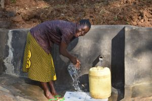 The Water Project:  Everline Wahing Hands Before Fetching Water