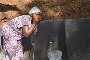 The Water Project:  Fatuma Drinking Water From The Spring