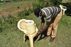 The Water Project:  Ibrahim Chetambe Washing Hands