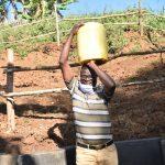 The Water Project: Mushikulu B Community, Olando Spring -  Ibrahim Collecting Water