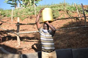 The Water Project:  Ibrahim Collecting Water
