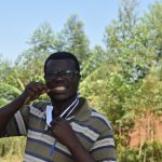 The Water Project: Mushikulu B Community, Olando Spring -  Ibrahim Demonstrating How To Brush Teeth