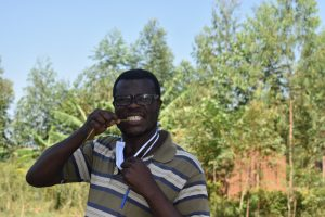 The Water Project:  Ibrahim Demonstrating How To Brush Teeth