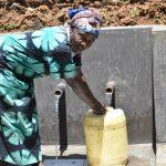 The Water Project: Mushikulu B Community, Olando Spring -  Mwanaisha Omumia Fetching Water