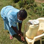 The Water Project: Mushikulu B Community, Olando Spring -  Peletina Oloyo Rinsing Hands