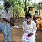 The Water Project: Mabanga Community, Ashuma Spring -  Giving Participants Masks