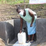 The Water Project: Mabanga Community, Ashuma Spring -  Fetching Water From The Protected Spring