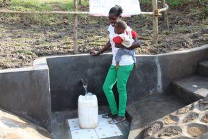 The Water Project:  Fetching Water With Her Baby