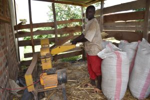 The Water Project:  Community Member Grinding Animal Feed