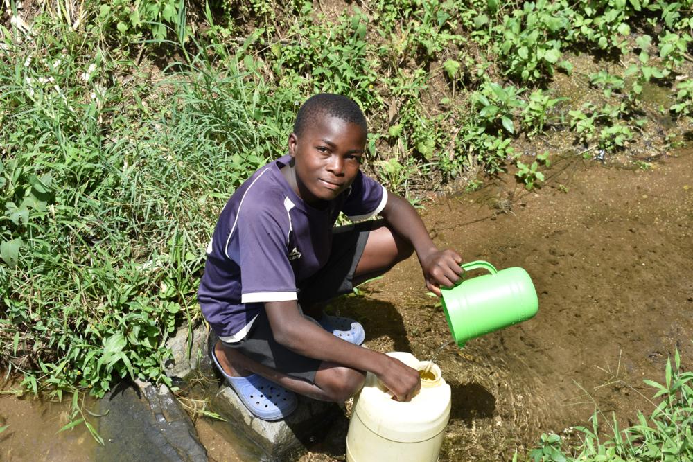 The Water Project : kenya21322-joseph-fetching-water