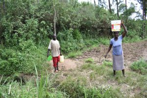 The Water Project:  People Carrying Water