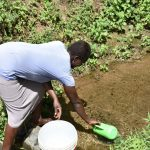 The Water Project: Emuyere Community, Kaikai Spring -  Selpher Scooping Water
