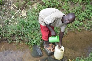 The Water Project:  Man Fetching Water