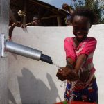 The Water Project: Lokomasama, Rotain Village -  Child At The Complete Well