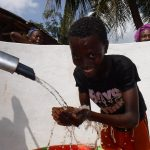 The Water Project: Lokomasama, Rotain Village -  Child Celebrates The Well