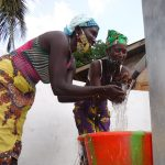 The Water Project: Lokomasama, Rotain Village -  Splashing At The Well
