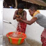 The Water Project: Lokomasama, Rotain Village -  Splashing Water From The Well