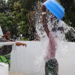 The Water Project: Lungi, Suctarr, #47 Kamara Street -  Dumping Water In Celebration