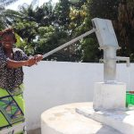 The Water Project: Lungi, Suctarr, #47 Kamara Street -  Woman Pumps The Well