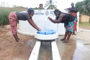 The Water Project:  Splashing The Water From The Well