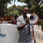 The Water Project: Lokomasama, Satamodia Village -  Ward Councilor Paul Dickson Making Statement