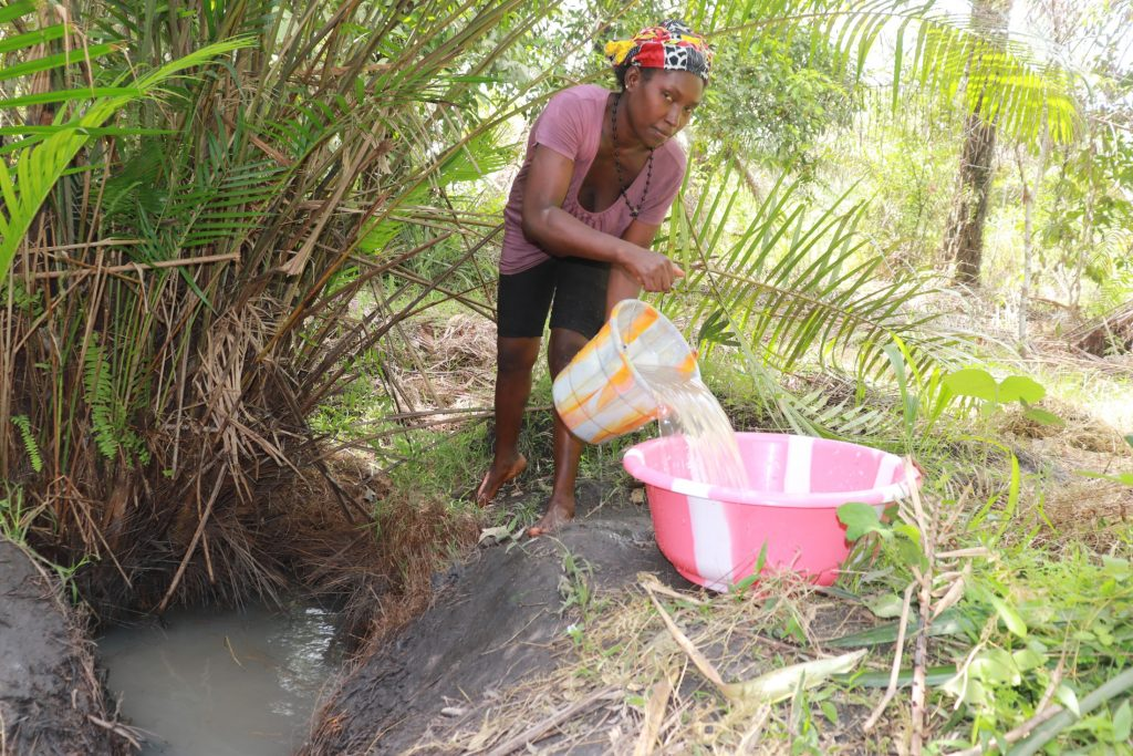 The Water Project : sierraleone21541-woman-collecting-water
