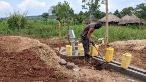 The Water Project:  Leveling The Ground Around The Well