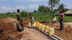 The Water Project:  Margret Nambuya Speaks With The Well Caretaker