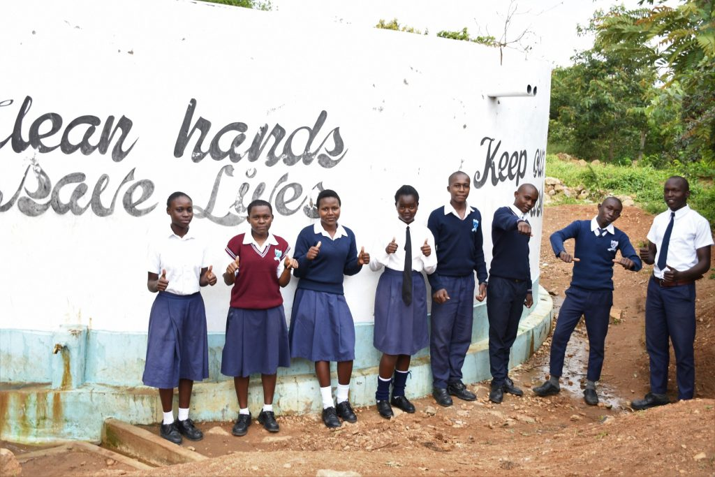 The Water Project : kenya20353-students-drink-water-from-the-tank