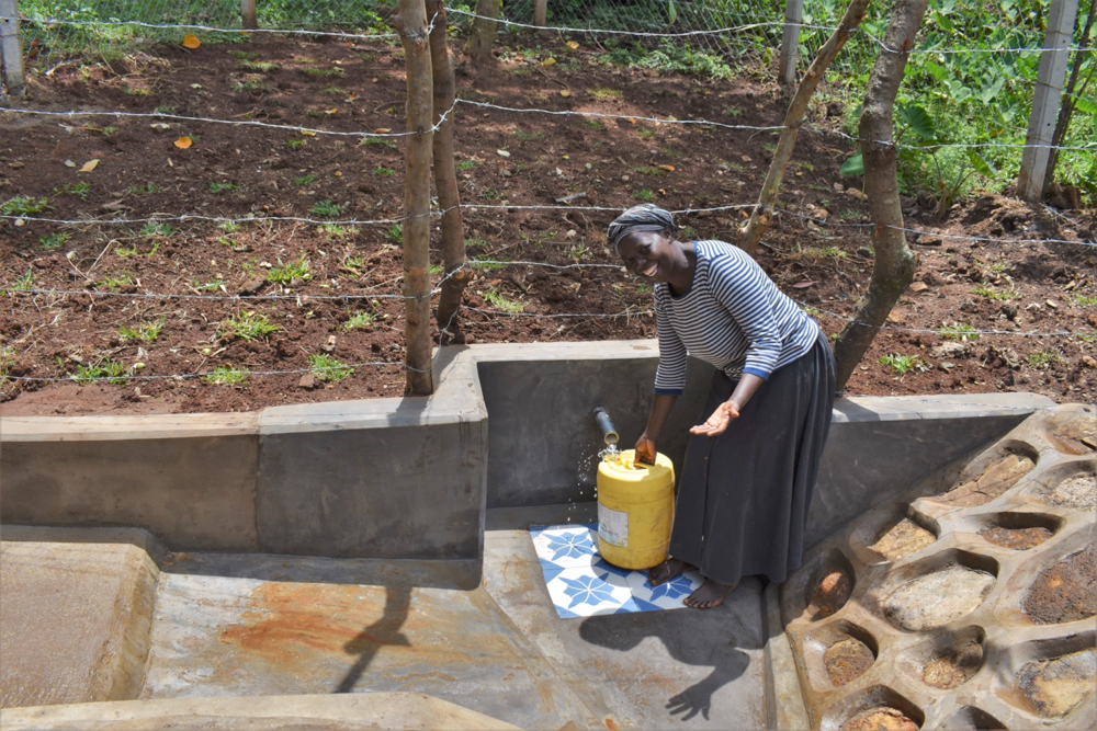 The Water Project : kenya21004-fetching-water-from-shatuma-sping