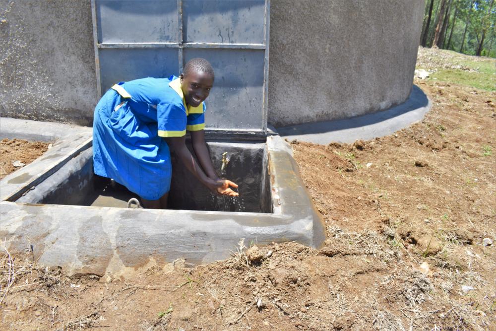 The Water Project : kenya21221-a-girl-enjoying-water