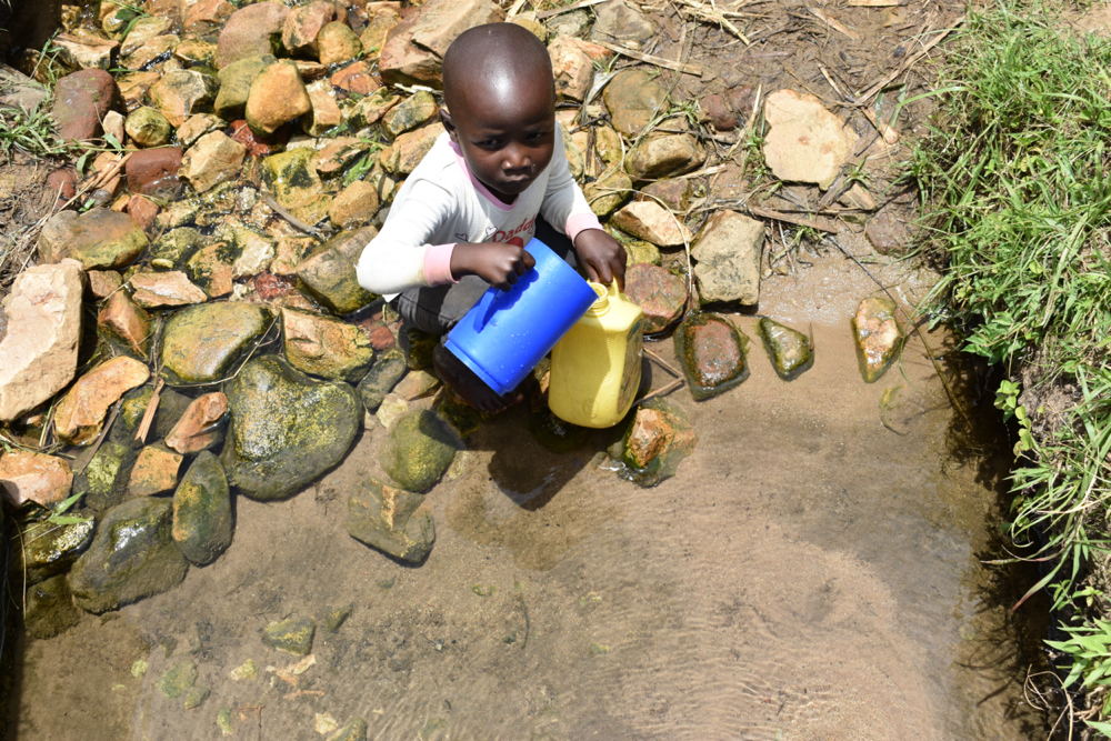 The Water Project : kenya21306-a-child-collecting-water