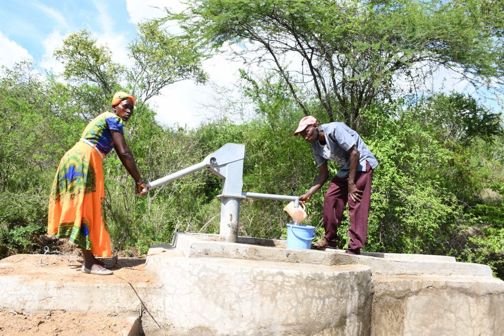 The Water Project : kenya21405-fetching-water-form-the-new-well