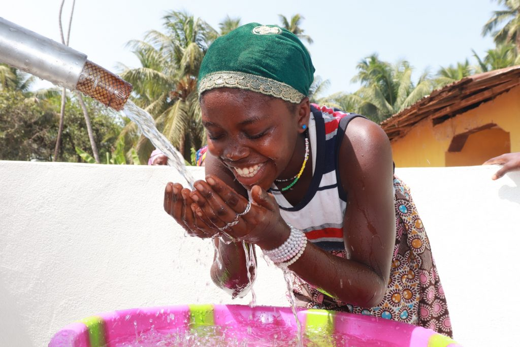The Water Project : sierraleone21512-girl-drinks-from-the-well-2