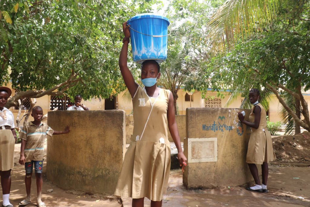 The Water Project : sierraleone21548-student-carrying-water-1