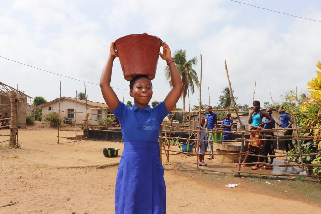 The Water Project : sierraleone21569-student-carrying-water-2