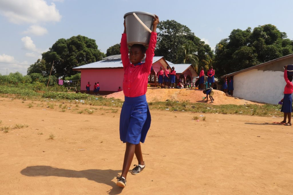 The Water Project : sierraleone21547-student-carrying-water-3