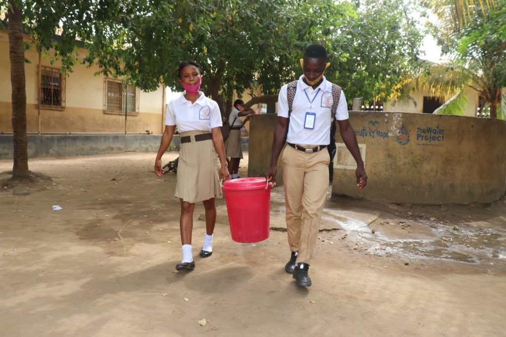 The Water Project : sierraleone21549-student-carrying-water-1