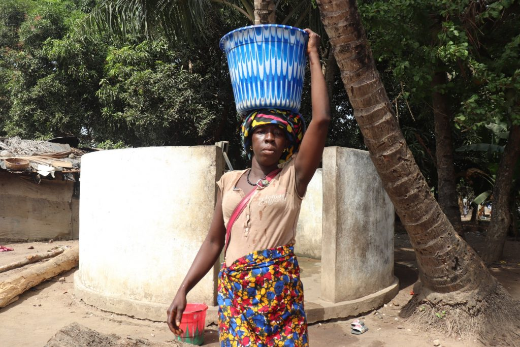 The Water Project : sierraleone21550-woman-carrying-water-1