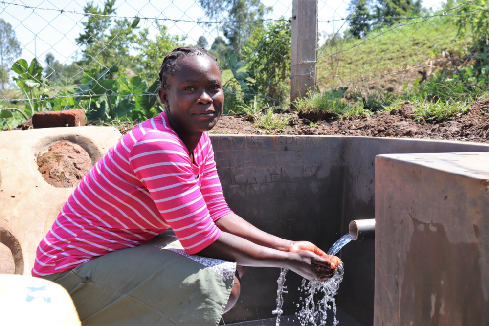 The Water Project : kenya21015-enjoying-the-flowing-water-9