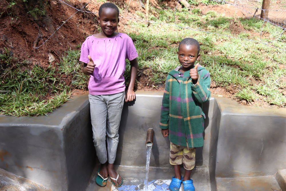The Water Project : kenya21041-faith-and-her-brother-posing-at-the-spring