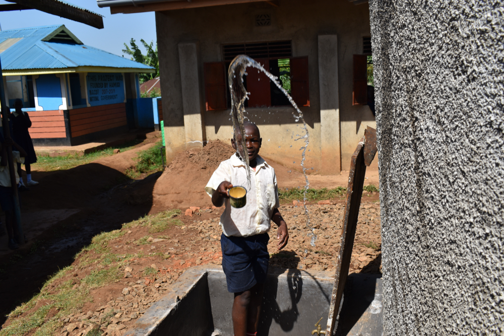 The Water Project : kenya21218-student-celebrating-for-reliable-water
