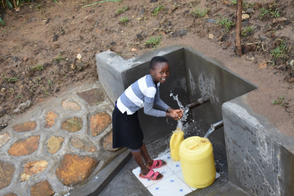 The Water Project : kenya21306-happy-child-fetching-water