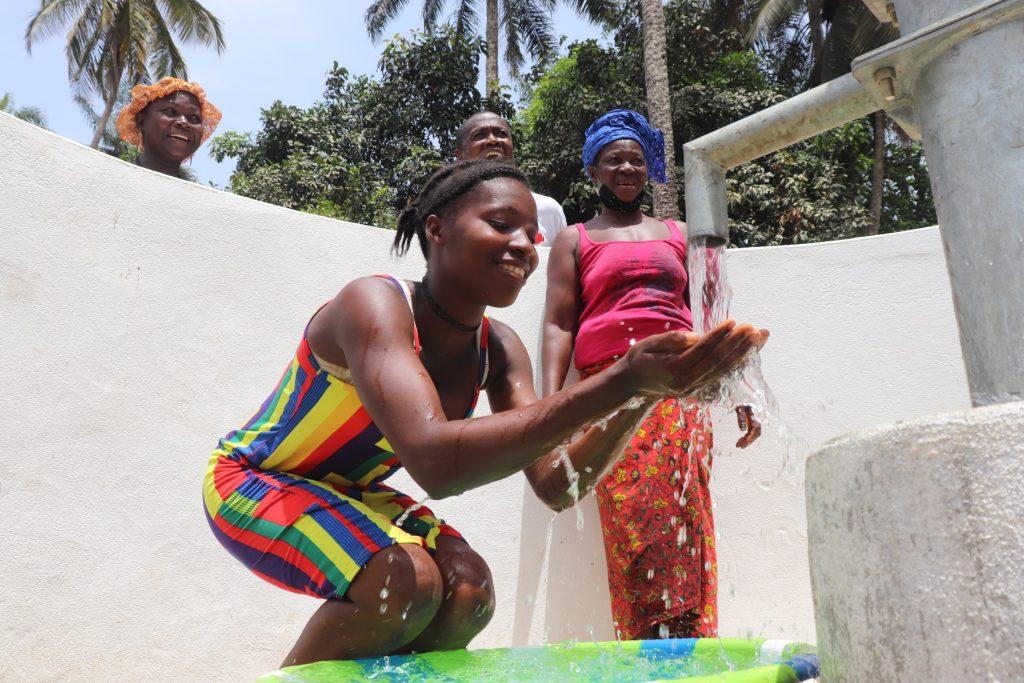 The Water Project : sierraleone21519-girl-splashing-water