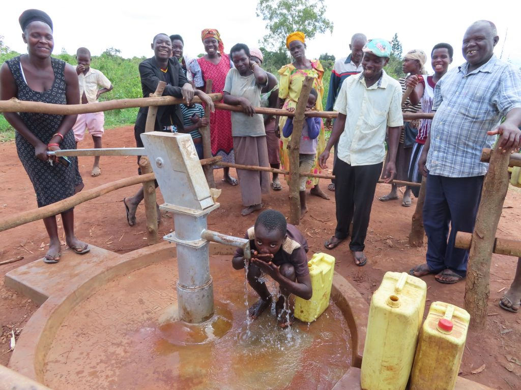 The Water Project : uganda21603-child-drinks-from-the-well