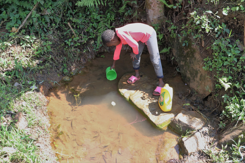 The Water Project : kenya21002-beril-fetching-water-2