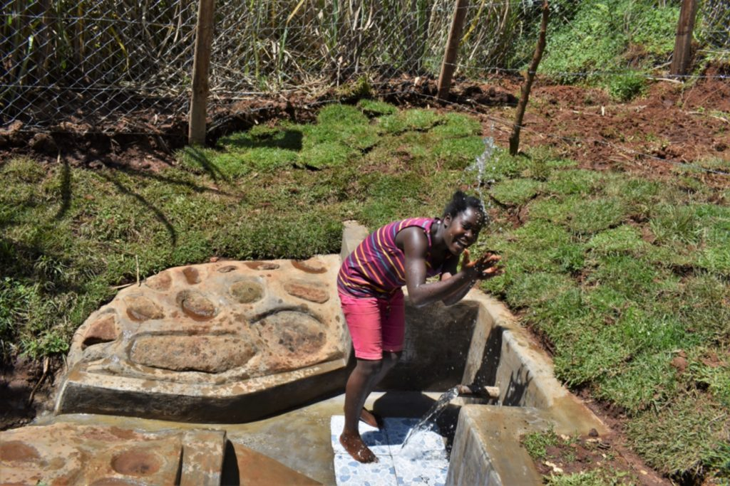 The Water Project : kenya21017-playing-with-water-2